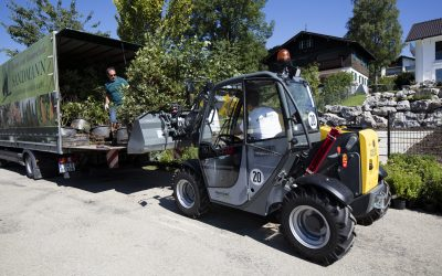 Garden machines in application for a green oasis on the fringe of the Alps